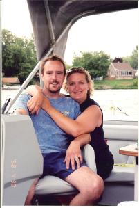 Me and my hubby, enjoying a ride on our pontoon boat.